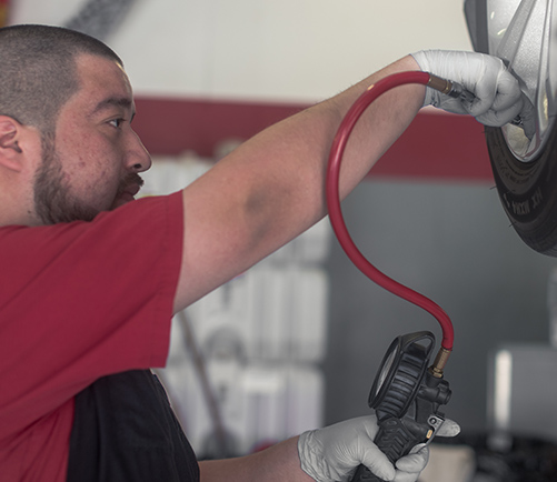 Tire Repair and Replacement - Auto Lab Complete Car Care Centers - content-tire-filling
